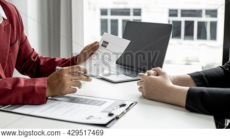The Manager Is Interviewing Job Applicants And Reading The Candidate's Personal Information On The R