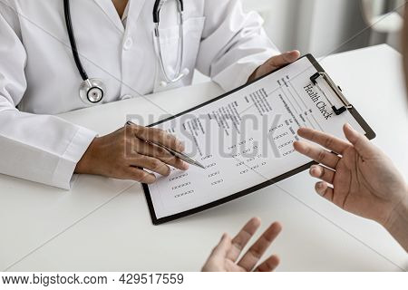 The Doctor And The Patient Are Discussing The Details Of The Treatment, The Results Of The Physical