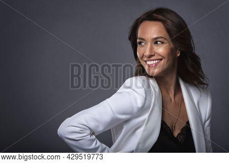 Happy And Attractive Mature Woman Studio Portrait