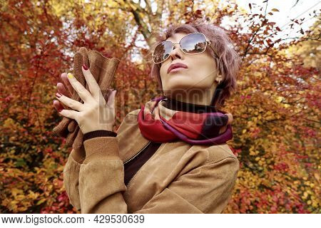 A Model With Accessories And A Multicolored Manicure In Autumn.