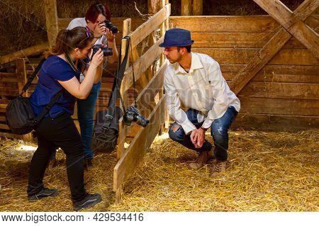 Ivanovo, Vojvodina, Serbia - April 17, 2016: Two Creative Female Photographers Are Taking Photo Toge