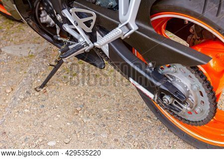 View On Rear End Of Motorcycle Gear Wheel With Chain Back Wheel.