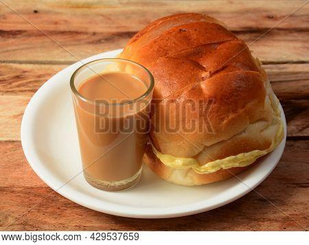 Indian Masala Chai With Bun Maska Bread On White Plate, Selective Focus