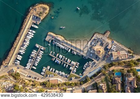 Drone Point Of View Directly From Top Cabo Roig Harbor With Moored Docked Luxury Nautical Vessel In
