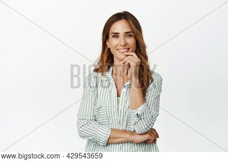 Ambitious And Confident Businesswoman Smiling Thoughtful, Looking At Camera Interested, Hear Ideas,