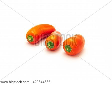 Three Organic Red Mini Sweet Peppers Snack Isolate On White