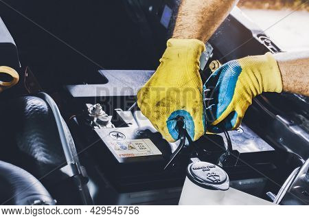 The Mechanic Pulled The Old Car Battery Out Of The Engine Compartment To Replace It With A New One