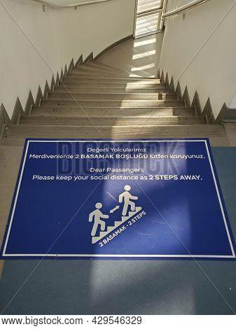 Precaution Banner On Floor With Text - Dear Passengers, Please Keep Social Distance As 2 Steps Away.