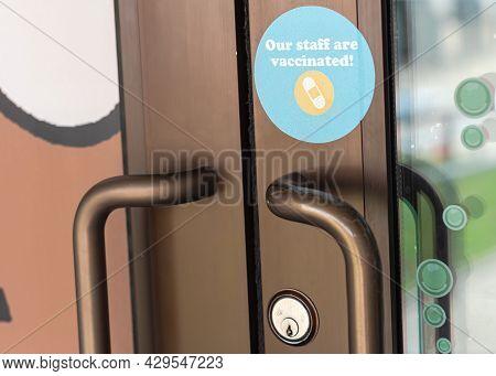 Coronavirus Vaccinated Sticker At Door Entrance Of Restaurant In Waco, Texas, America