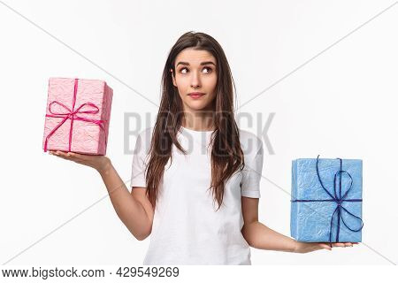 Celebration, Holidays And Presents Concept. Waist-up Portrait Of Cute, Dreamy Young Girl Wondering W