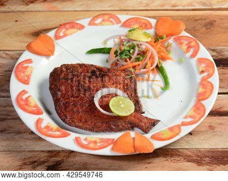 Pomfret Fish Fry - Deeply Fried Pomfret Fishes Which Is Well Garnished With Tomato, Lemon And Onion