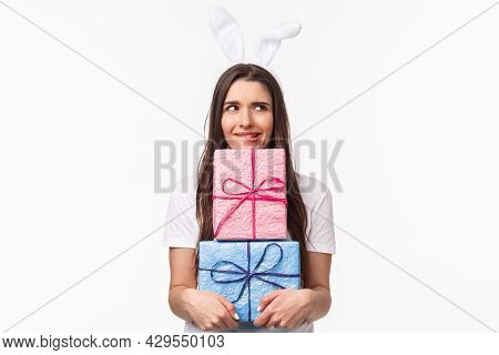 Celebration, Holidays And Presents Concept. Portrait Of Troubled And Doubtful Young Cute Girl In Rab