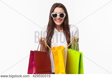 Shopping, Leisure And Lifestyle Concept. Portrait Of Excited Happy Young Girl Likes Shop, Attend Fav