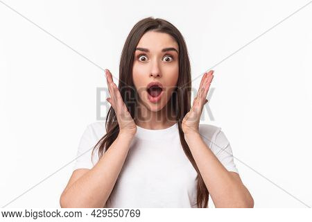 What An Amazing News. Surprised And Astonished, Excited Young Woman React To Something Awesome Happe