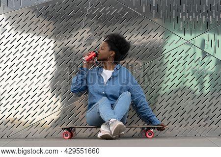 Tired African Skateboarder Girl Refreshing After Longboarding Sit On Skate Drinking Soda Beverage Fr
