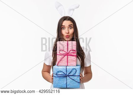 Celebration, Holidays And Presents Concept. Portrait Of Silly Beautiful Young Female In Rabbit Ears,