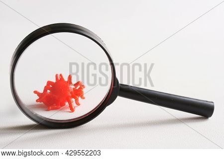 The Toy Is A Virus Under A Magnifying Glass. Concept For The Study And Research Of Changes And Mutat