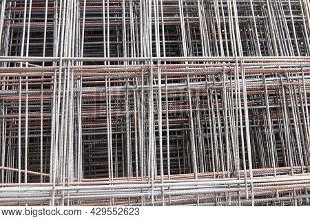 Selective Focus Close-up Background Of Reinforcement Wire Mesh. Welded Reinforcing Steel Mesh For Re