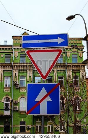 Traffic Signs In The City. One Way Street In Direction Of Right Arrow Road Sign, Give Way Priority Y