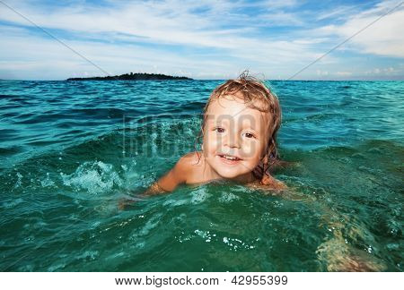 Kid Swimming In The Sea
