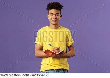 Portrait Of Young Hispanic Male Student Studying Online Courses, Writing Down Lecture, Making Person