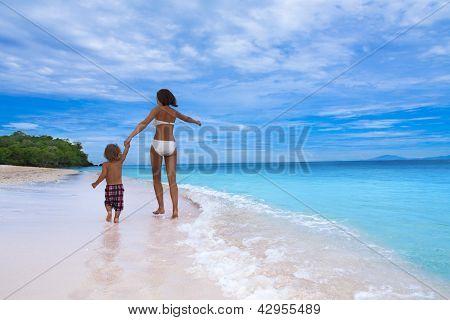 Mom And Son Running On Seashore
