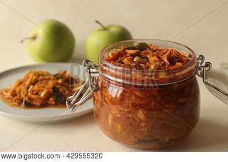 Sweet And Spicy Pickled Green Apple Or Achar Made With Finely Sliced Green Apple Preserved In Brine,