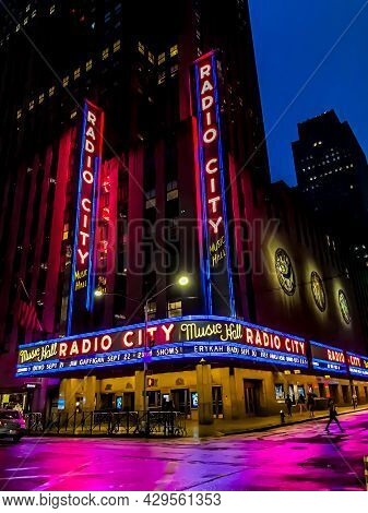 Exterior Of The Iconic Radio City Music Hall Theatre (home Of The Rockettes) With Colorful Neon Marq