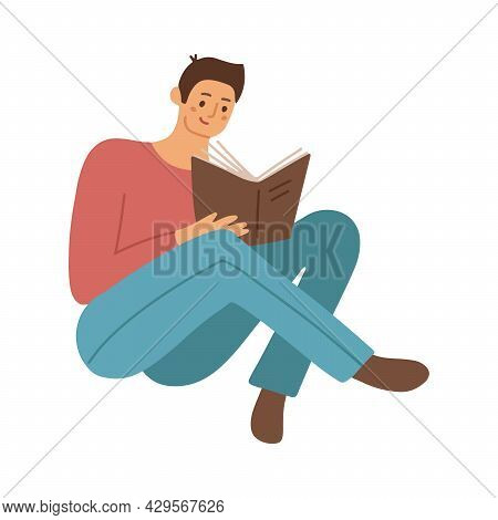 Smart Student Preparing For Exam At Home. Young Man Studying And Reading Book. Male Reader Sitting O