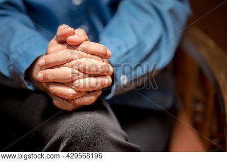 Close Up Of Faithful Praying