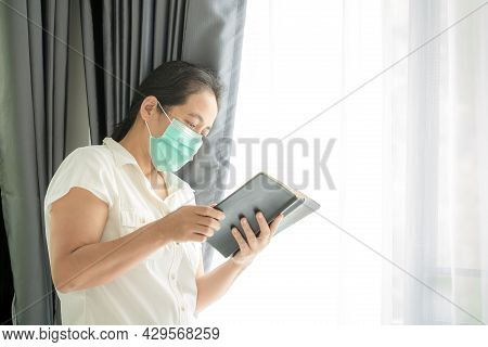 Religious Woman In Protective Face Mask And Praying To God