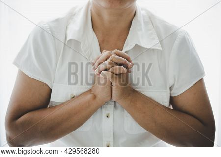 Woman Pray For God Blessing To Wishing Have A Better Life.
