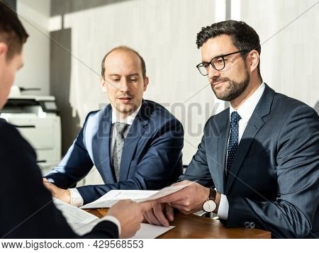 Close-up Of Businessperson Signing Contract, Woman Writing Paper At The Desk With Pen And Reading Bo