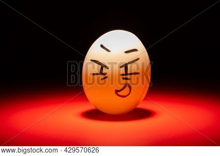 Smiling Egg Face Highlighted In Dark Space