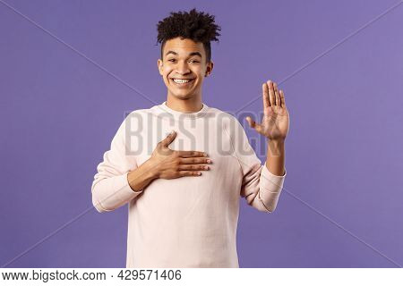 Portrait Of Young Happy, Joyful Hispanic Man Making Honest Statement, Promise To Tell Only Truth, Ho