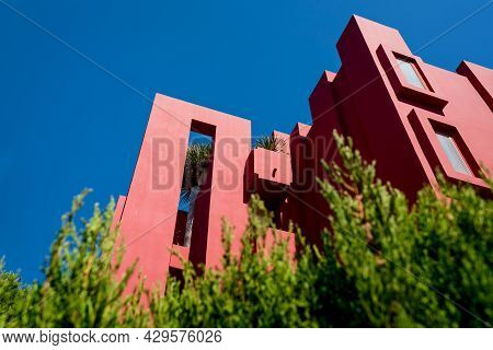 Calpe, Spain - 19 July 2021: Low Angle View On The Postmodern Apartment Building 'la Muralla Roja',