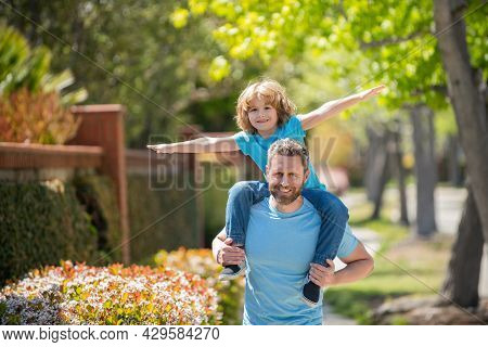 Happy Dad With Son Having Real Fun Together In Park, American Family