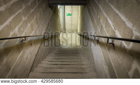 An image of stairs down to the basement
