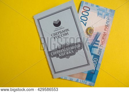 Moscow, Russia 04/15/2021 Savings Book Of Sberbank Of Russia And Paper Ruble Notes. Deposits In Rubl