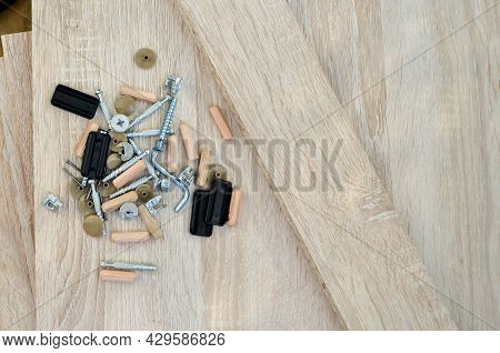 Chipboard Sheets And Components For Furniture Assembly Close-up. Manufacturing And Self-assembly Of