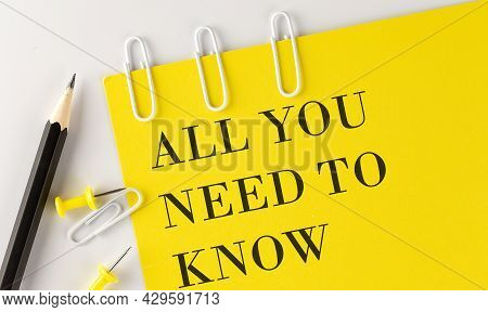 All You Need To Know Word On The Yellow Paper With Office Tools On White Background