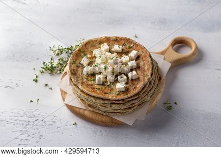 Homemade Yeast-free Gluten-free  Buckwheat Flat Bread With Feta Cheese, Thyme And Spices On A Wooden