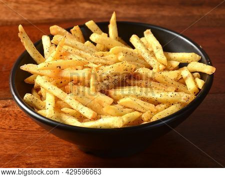 Mix Herb French Fries, Served In A Plate Over A Rustic Wooden Background, Indian Cusine, Selective F
