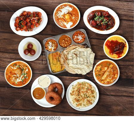 Assorted North Indian Foods Veg Thali,roti,malai Kofta,paneer Butter Masala,veg Manchurian And Birya