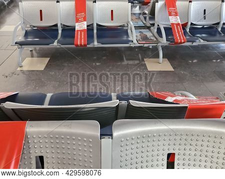 Empty Seats In Waiting Area Of Antalya Airport. Nearest Chairs Closed By Caution Ribbon With Keep So