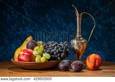 Still Life With Fruits. Grapes, Nectarines, Pears And Plums.