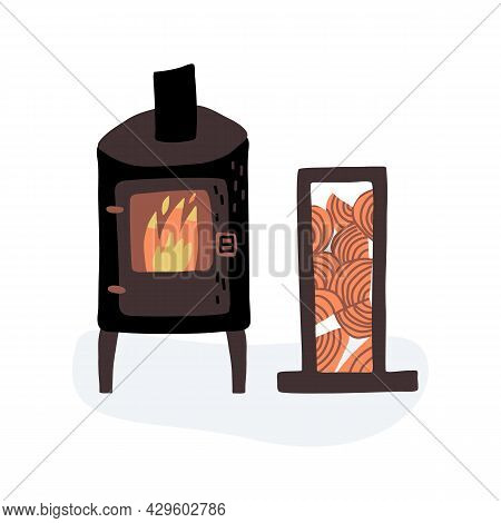 A Potbelly Stove With Burning Fire And Log Rack With Wood Stack For Kindling A Fire In The Stove.