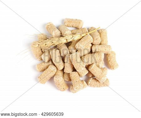 Pile Of Granulated Wheat Bran And Spikelet On White Background, Top View