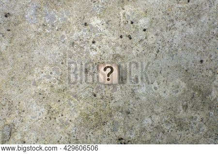 A Question Mark On The Wooden Cubes On A A Cement Background . Faq Frequency Asked Questions, Answer