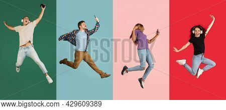 Four Young Cheerful People, Men And Women In Motion Isolated Over Colored Backgrounds. Flyer
